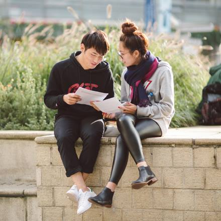 Image of two Asian students sitting in Square 4 at the Colchester Campus
