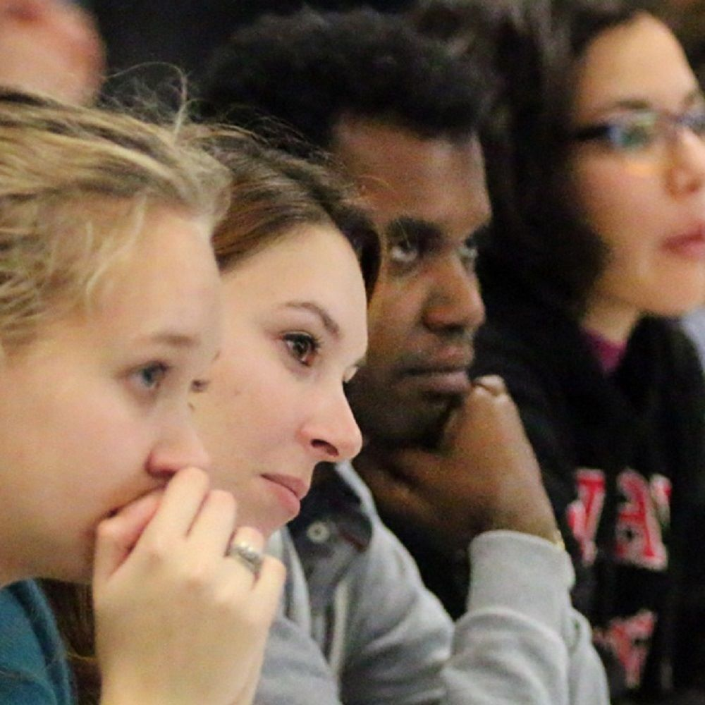 Four students faces during lecture