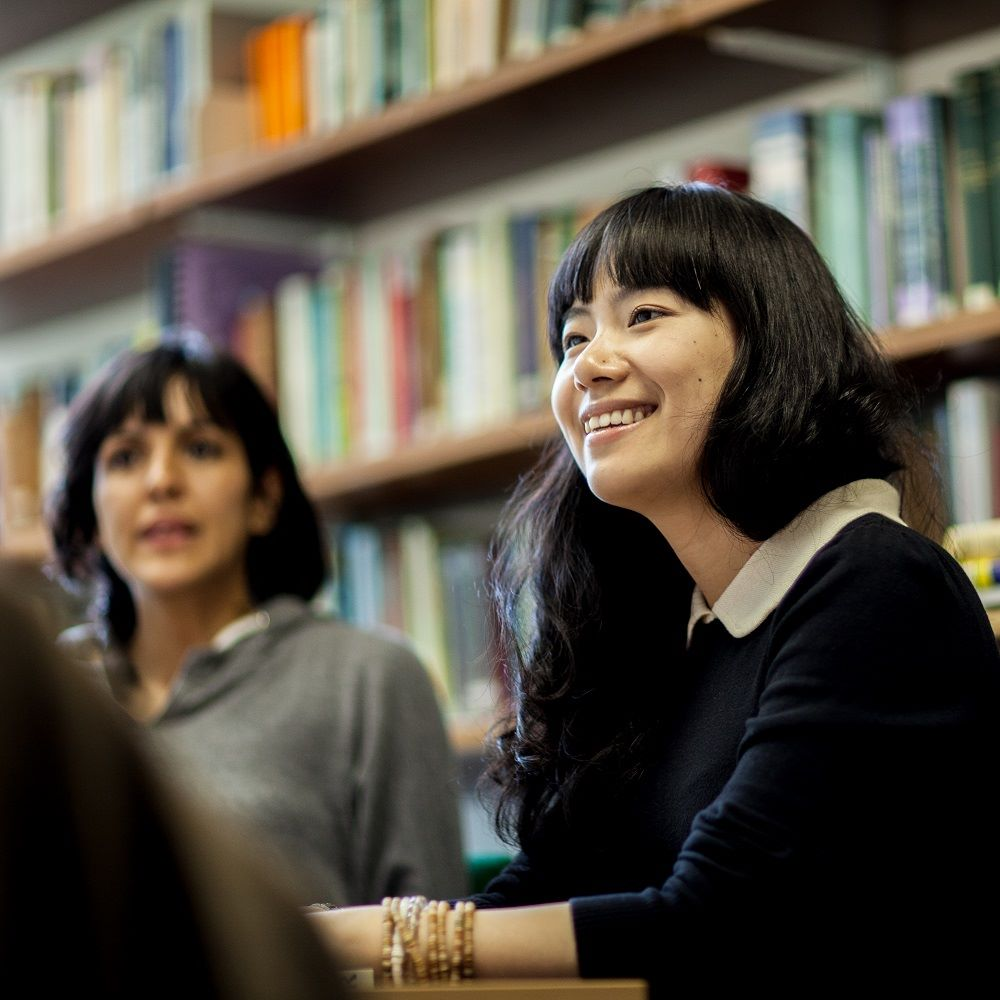 Two students talking in Library
