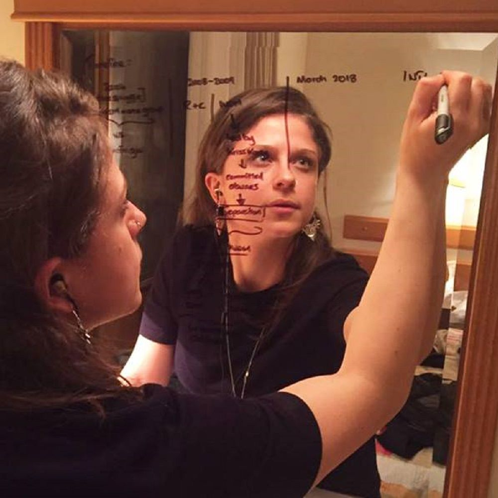 Student drawing on a mirror