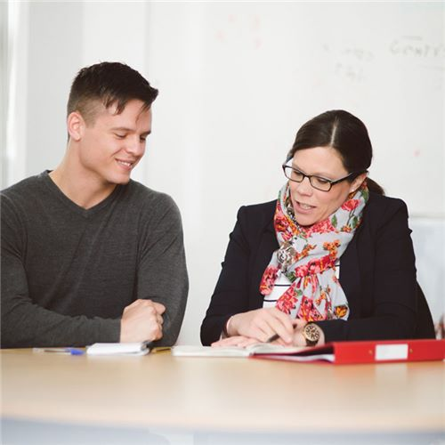 A tutor talking with a University of Essex student